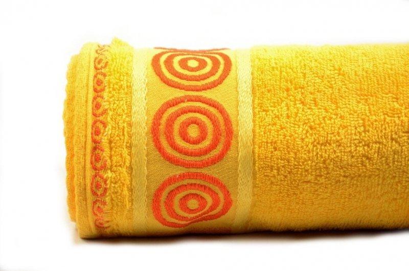 Ręcznik frotte z ozdobnym paskiem żółty pomarańczowy