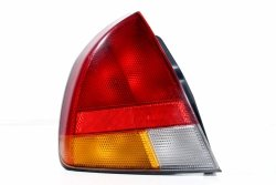 Lampa tył lewa Mitsubishi Carisma DA1A 1995-1999 5D