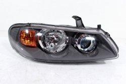 Reflektor prawy Nissan Almera N16 2003-2006 Lift (szary)