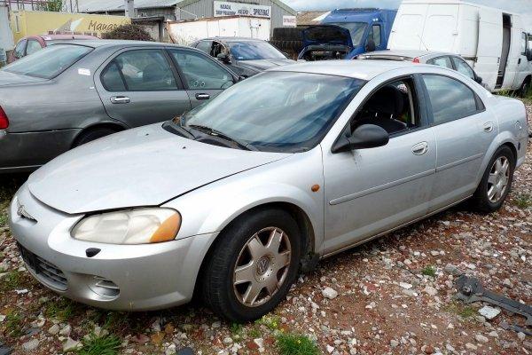 Klamka zewnętrzna przód lewa Chrysler Sebring 2002 2.0i Sedan (kod lakieru: PS2)