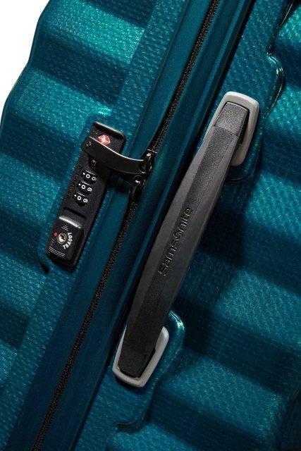 Bagaż posiada zamek szyfrowy TSA oraz boczny uchwyt