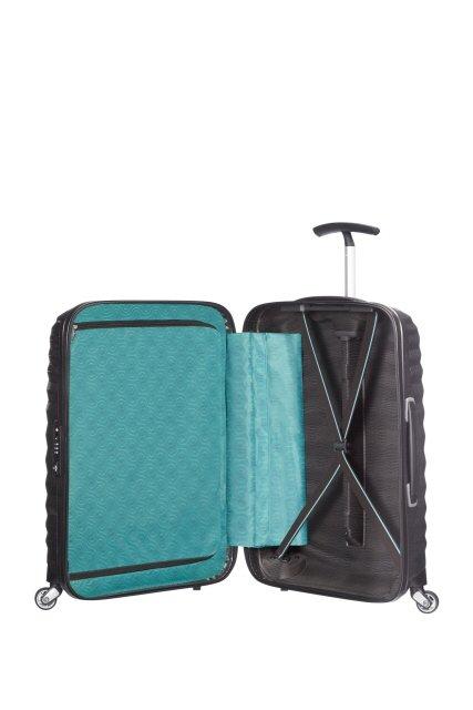 Bagaż wewnątrz posiada po jednej stronie materiałową przekładkę zapinaną na suwak, a po drugiej pas spinający ubarania