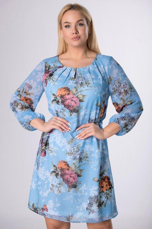 tiulowa sukienka z zakładkami przy dekolcie i bufiastymi rękawami