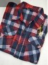 Koszula polarowa granatowa w czerwoną kratkę.