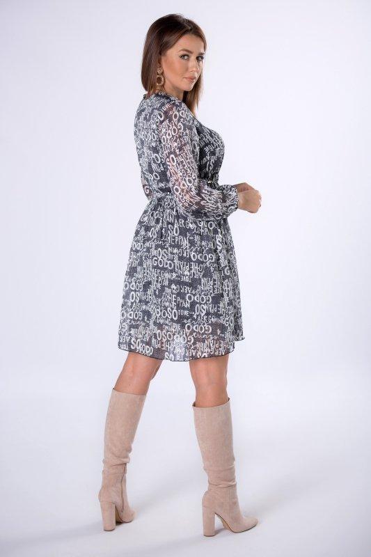 tiulowa sukienka ze ściągaczem w pasie i bufiastymi rękawami