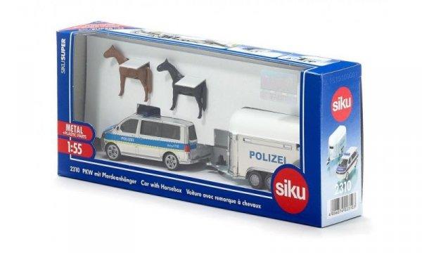 Samochód policyjny z przyczepą dla koni