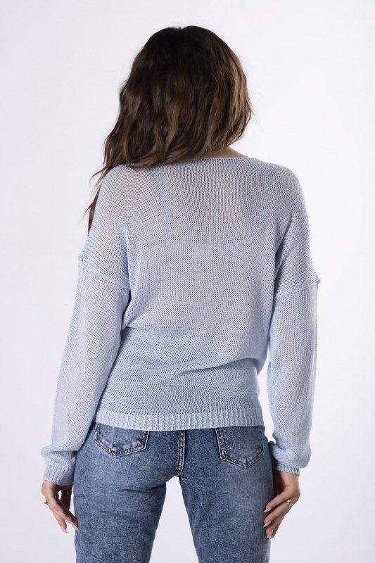 sweter z połyskującą aplikacją