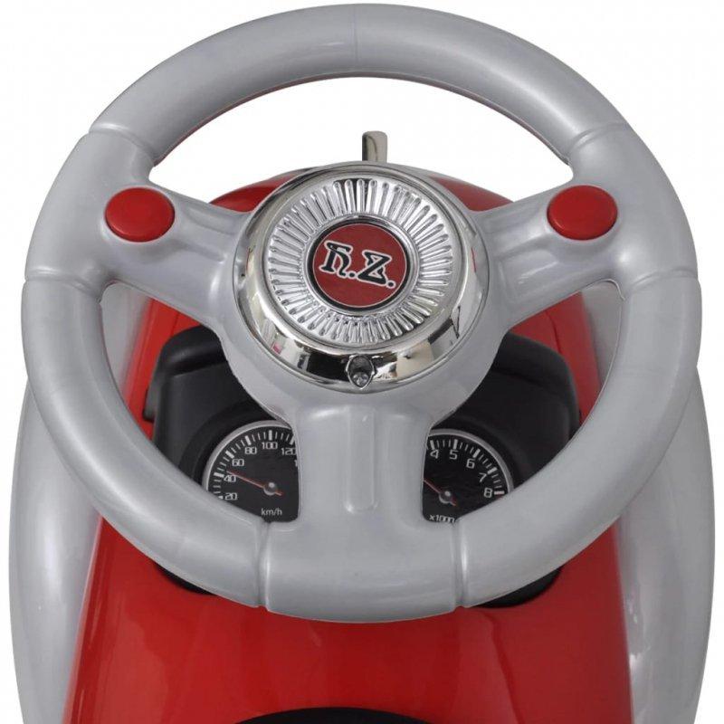 Czerwony samochód-jeździk retro z drążkiem do pchania