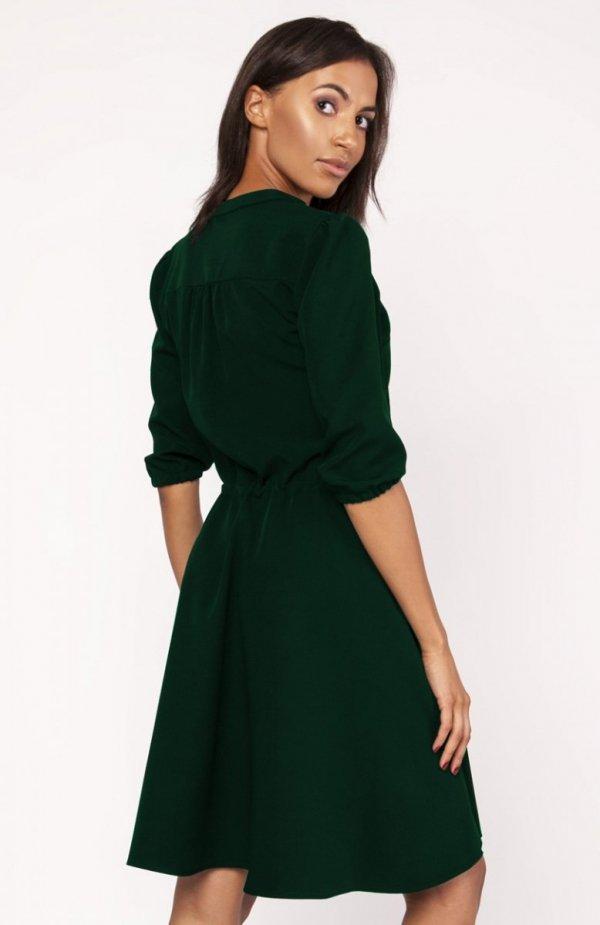 Sukienka o rozkloszowanym dole zielona SUK156 tył