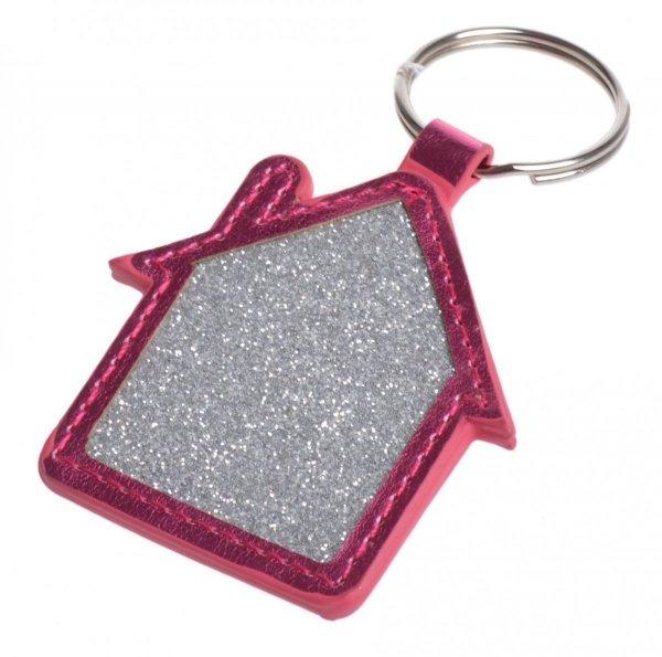 Połyskujący srebrny breloczek - domek z różową lamówką. Wymiary bez kółka: 6x6cm.